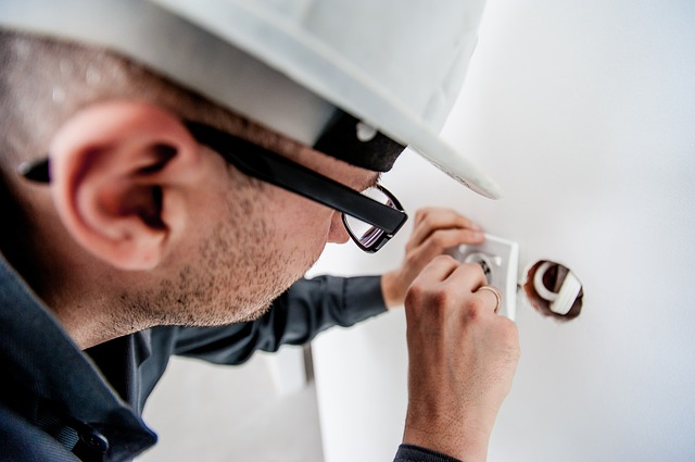 electrician mending a switch